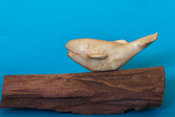 Smiling blue whale carving