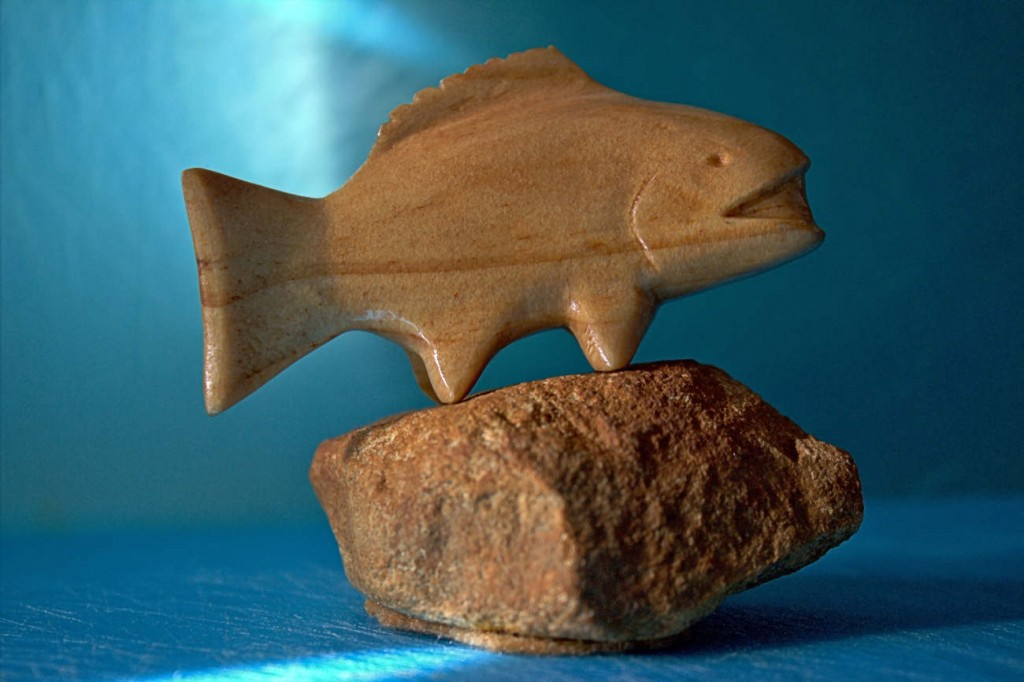 whittled small fish from wood